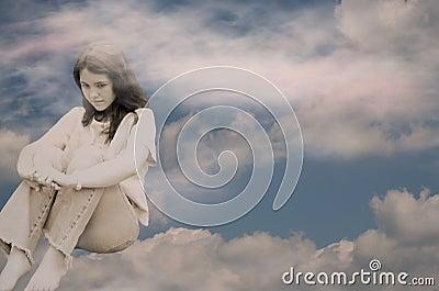 Depressed teen girl in clouds