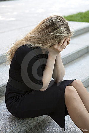 Depressed teen girl sitting on stairs