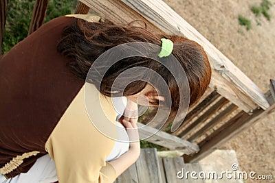 Depressed teen girl on stairs