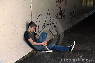 Depressed teen by graffitti