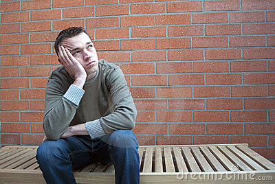 Depressed thinking young man