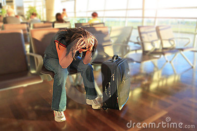 Depressed woman awaiting for plane