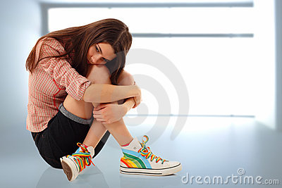 Depression teen girl lonely in room
