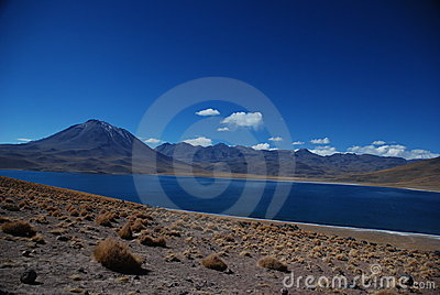 Desert lake and volcanoes