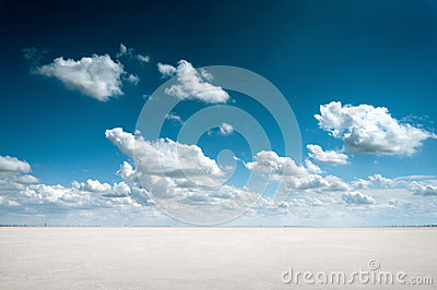 Desert landscape with deep blue sky and clouds