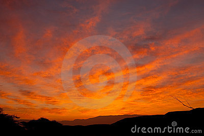 Desert red sky with clouds