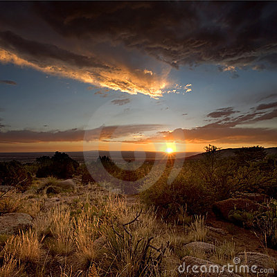 Free Desert Scenics: Stormy Sunset Stock Images - 19933454