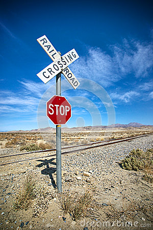 Free Desert Stop Sign And Railroad Crossing Stock Images - 34489344