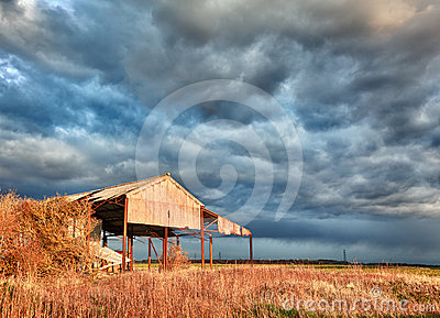 Deserted barn in storm