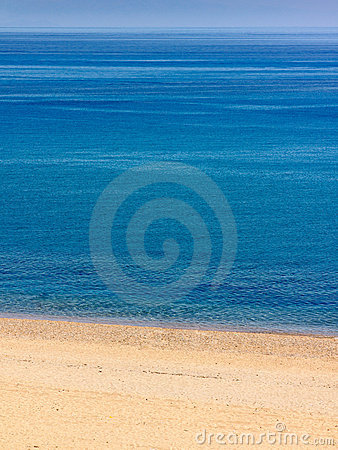 Deserted beach with brilliant blue sea