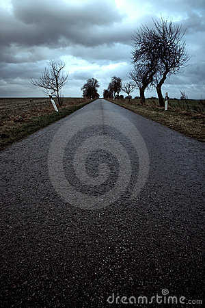Free Deserted Road Under Stormy Sky Royalty Free Stock Images - 5221009