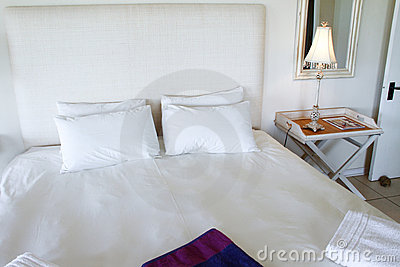 Designer bed in a luxury bedroom