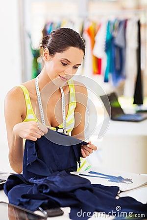 Designer choosing fabric