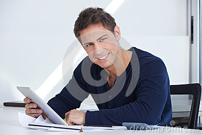 Designer at desk with tablet computer