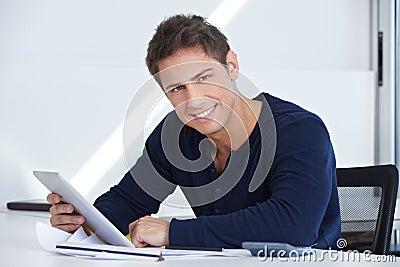 Designer at desk with tablet computer