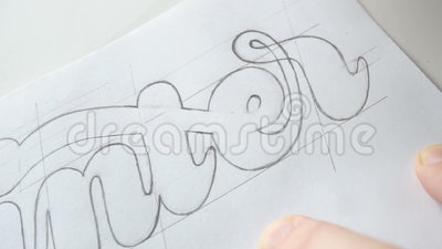Designer Drawing Letters With Pencil Text Paint