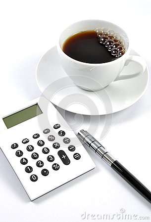 Desk with a calculator and pen