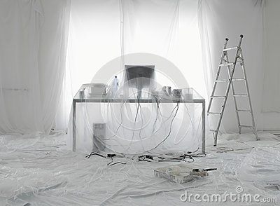Desk And Computer Covered In Transparent Dust Sheets