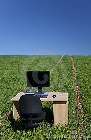 Desk and Computer In Green Field With Path