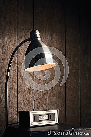 Desk lamp and retro clock.