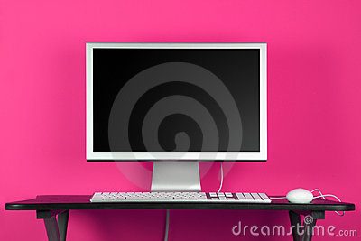 Desktop computer and pink wall