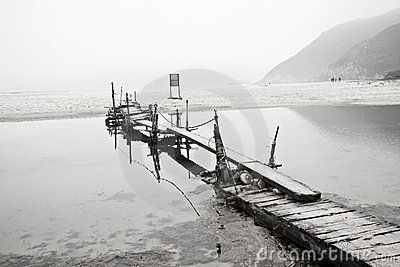 Desolated pier next to the sea