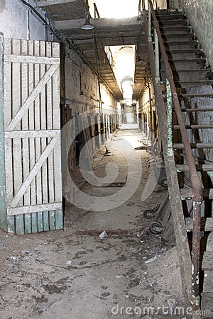 Despair: Hallway of abandoned and decaying prison