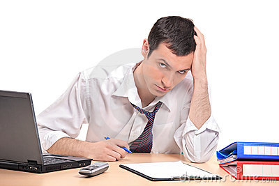 A desperate businessman in his office
