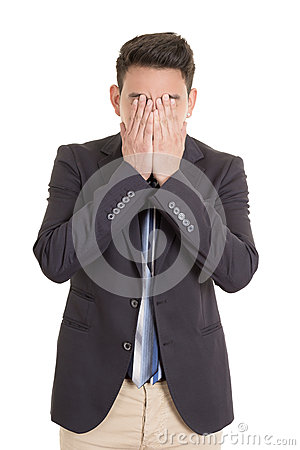 Desperate hispanic man with hand in face