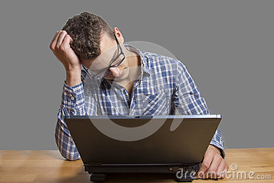 Desperate Man sitting at the Computer
