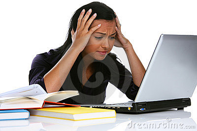 Desperate young woman with a laptop computer