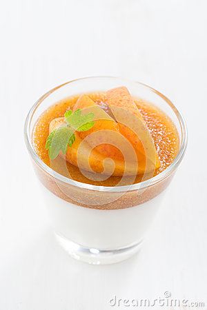 Dessert with cream and apricot jelly and mint, top view