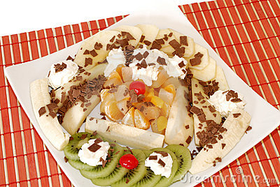 Dessert with fresh fruit and whipped cream.