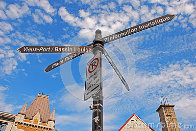 Destination Signs for four directions at Quebec City Old Town Editorial Stock Photo