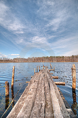 Destroyed wooden bridge on the lake