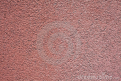 Detail of brown textured stucco wall