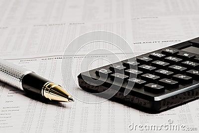 Detail of a business pen near a calculator