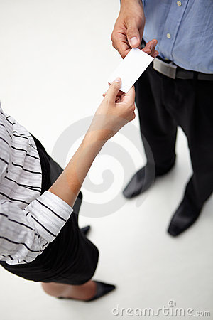 Detail businessman and woman exchanging cards