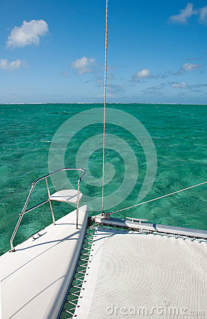 Detail of catamaran with turquoise water background