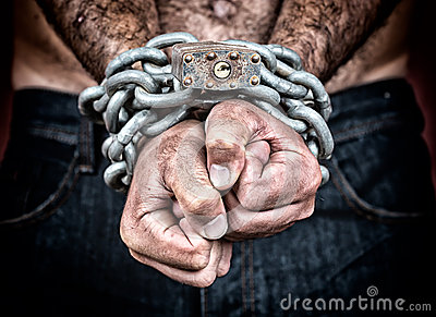 Detail of the chained hands of a man