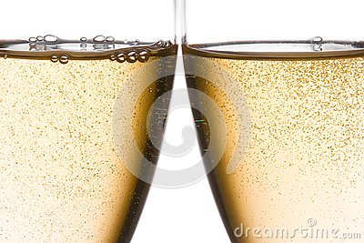 Detail of cheers with two champagne glasses with gold bubbles