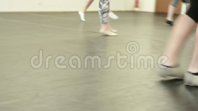 Girls in a dance class at a studio. Detail of a dance class showing ballet shoes and girls dancing stock video footage
