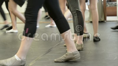 Girls in a dance class at a studio. Detail of a dance class showing ballet shoes and girls walking stock footage