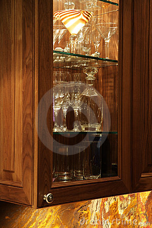 Detail of dark wooden furniture. Kitchen.