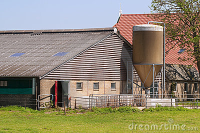 Detail of farm with stable and silo