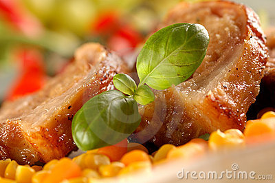 Detail of grilled pork with herbs
