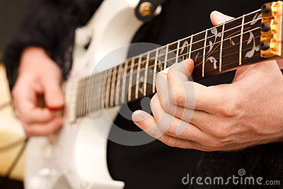 Detail of guitarist hands.