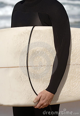 Detail of a man holding a surfboard