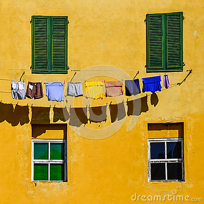 Free Detail Of Colorful Yellow House Walls, Windows And Clothes Royalty Free Stock Photography - 34166117