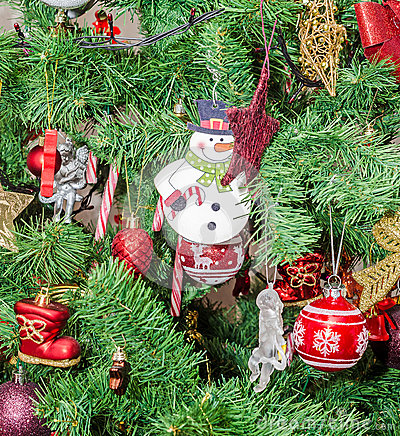 Free Detail Of Green Christmas (Chrismas) Tree With Colored Ornaments, Globes, Stars, Santa Claus, Snowman Royalty Free Stock Photography - 48022167